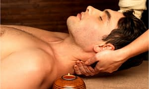 The therapist massaged the patient's neck.