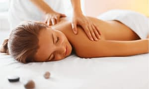 The woman sleeps during her massage treatment.
