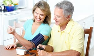 couple checking blood pressure