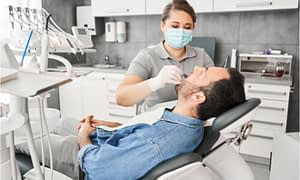 dentist taking impression