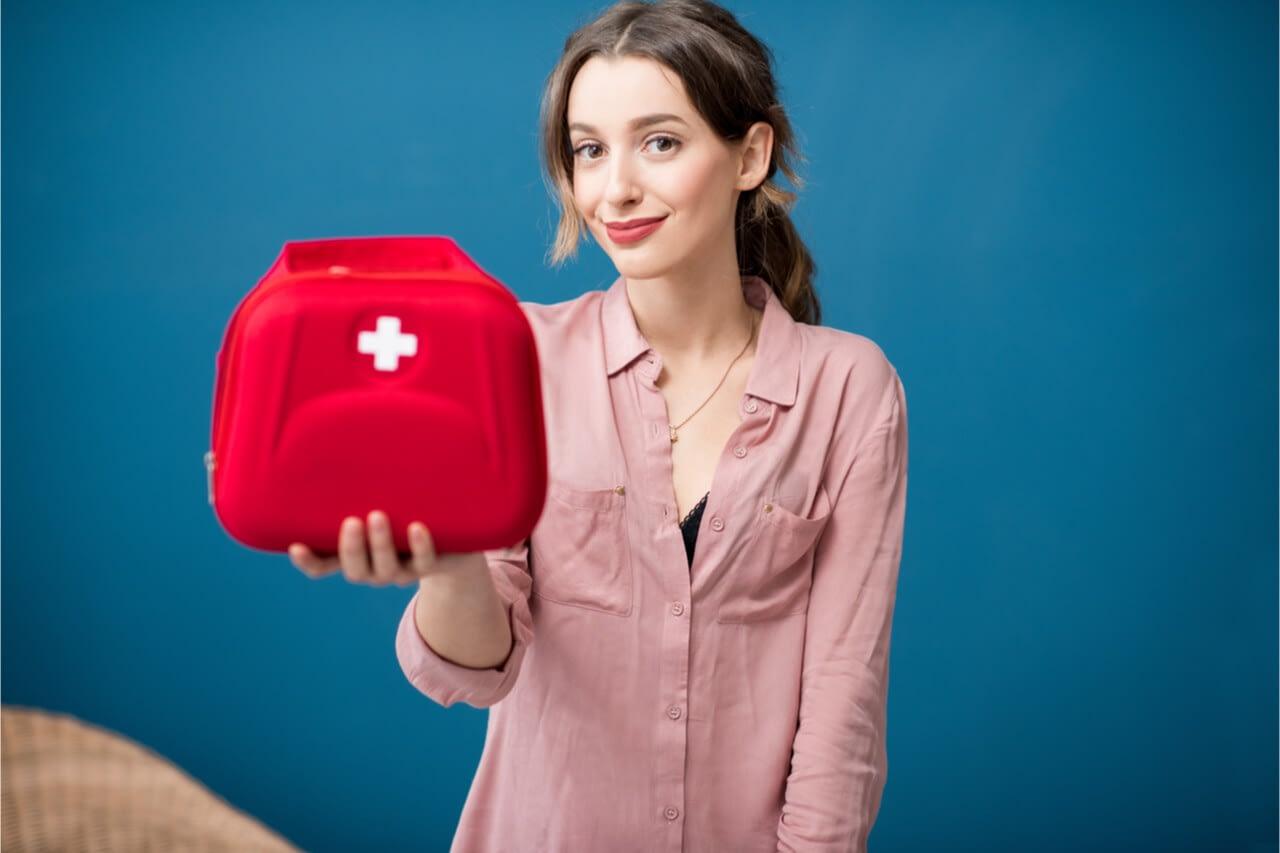 woman holding medical kit
